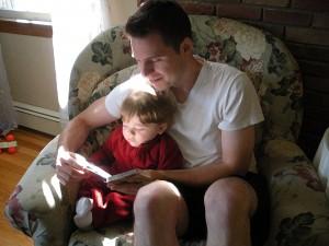 Father reads with son...